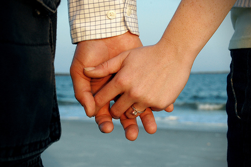 image of two people holding hands to illustrate that social media and seo go hand in hand